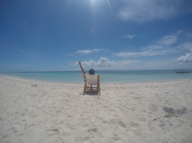 We brought the chair all the way to the beach front just to take this photo!